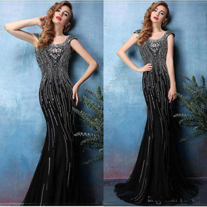 2017 Elie Saab Black Bead Mermaid Prom Dresses Lungo scollo rotondo Backless Crystal Abiti da sera Vintage manica corta tromba Satin Party Dress