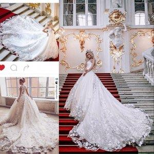 Apliques florales 3D Vestidos de novia Una línea de encaje ApplIique Key-Whole Sheer Back Vestidos de novia sexy Vestidos de boda de tren de capilla de tul magnífico