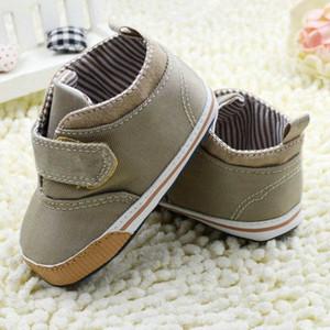 Venta al por mayor- Bebés recién nacidos de algodón del tobillo de lona Zapatos de cuna alta Zapatilla de deporte informal Niño primeros caminantes
