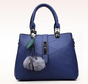 Doble 11.11 Precio de la promoción Nuevo bolso del tatuaje bola de lana Apliques colgante lichi bolso del bolso diagonal de las mujeres