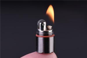 El queroseno más pequeño del mundo encendedor! Altura 2,5 cm / 1,3 cm Cápsula encendedor miniatura de metal portátil EDC engranaje impermeable Tiny maní encendedor