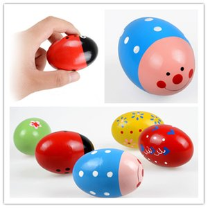 Bebê de madeira Ovo de brinquedo 7 * 5cm bonito Maraca madeira Educacional Toy Orff instrumentos musicais coloridos Brinquedos Educativos