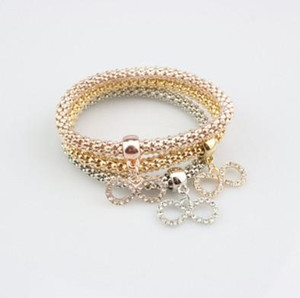 Braccialetto a catena Set Multistrato Oro / Argento / Oro rosa Hollow Lucky 8 Ciondolo Corn Chain Stretch Rope Bracciale Set