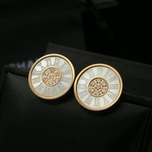 Orecchini in pietra intagliata a conchiglia circolare titanio conchiglia digitale centro, orecchini in titanio di commercio all'ingrosso di gioielli di moda
