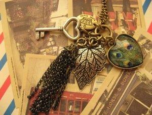 Nouveau pendentif colliers déclaration vintage bijoux femmes accessoires colliers rétro mode coeur feuille feuilles clé paon gland longues chaînes