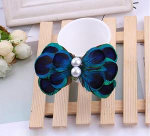 2017 moda nacional vento pena de pavão cabelo clipe banquete festa gravata borboleta forma de pérola ornamentos de cabelo por atacado