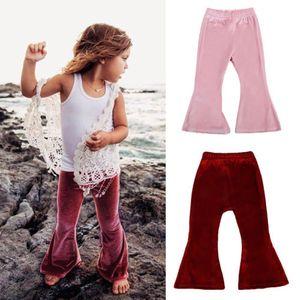 Ropa para niños de los bebés de los pantalones de las polainas del resorte niños del otoño Ropa Pleuche sólidos acampanados pantalones ocasionales de los niños de la llamarada pantalones 2 colores