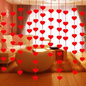 Il tessuto non tessuto che appende le decorazioni rosse del partito di giorno di San Valentino della stringa del cuore di colore rosso che intreccia le tende della porta della linea della festa nuziale trasporto libero