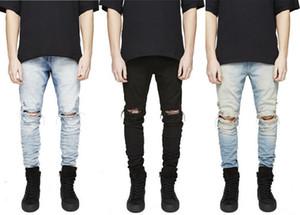 Diseñador Slim Fit rasgado agujeros rodilla pantalones vaqueros de los hombres de alta de la calle para hombre apenada dril de algodón Joggers envío libre Washed Destroyed Jeans Tamaño Plus