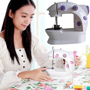 Máquina de coser de alta calidad Mini máquina de coser de trabajo hecho a mano bricolaje doméstico de doble velocidad con fuente de alimentación pequeño hogar DHL WX9-25