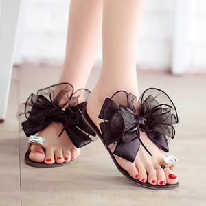 All'ingrosso-2015 signore di estate Bowtie sandali fiore sexy moda casual spiaggia femminile infradito donne grandi scarpe con strass scarpe K234