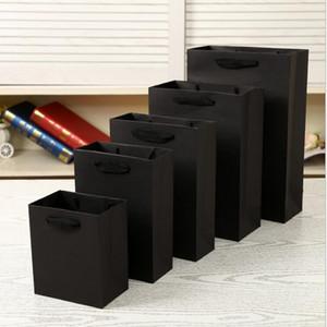 핸들 우수한 품질과 새로운 디자인 우아한 백색 흑색 종이 선물 가방 소형 크래프트 선물 가방 15 * 7 * 21CM