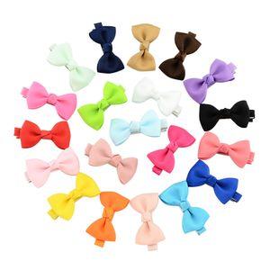 Lively Solid Clips 20pcs Pequeño Bowknot Hairgrips Mini dulces Ribbow Lazo para el cabello de seguridad Horquilla niños accesorios para el cabello hermoso HuiLin C92