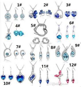 12 Set collana pendente di cristallo di alta qualità e orecchini Imposta una varietà di stili per Donna Jewelry Set
