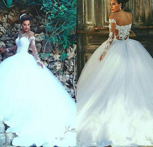 2017 New Arabic Ball Gown Wedding Dresses Illusion Long Sleeves Lace Appliques Tulle Formal Bridal Gowns Vestido de noiva