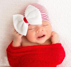 Dulce bebé niña invierno cálido neumático tapa recién nacido niños Vogue lentejuelas suaves Bling gran lazo sombrero de punto a rayas niños gorro gorros