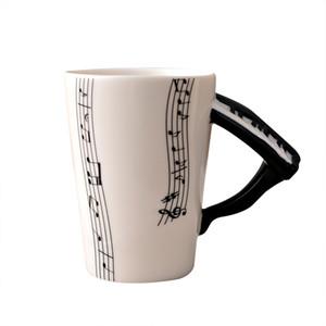 Großhandels-praktische keramische Musik-Ergebnis-Muster-Schalen-Becher mit dem Klavier-Handschaft-Kaffeetassen Hohe Qualität