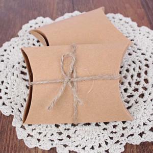 100Pcs / lot della carta kraft Cuscino Candy Box regalo di nozze per ospiti favori wedding e regali Box per i favori di partito Capodanno Natale dicembre