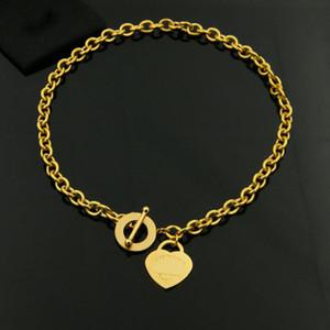 El anillo en forma de corazón oot hebilla agujero grueso titanio acero collar collar de oro rosa comercio al por mayor moda moda titanio acero joyería