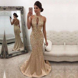 Neue wunderschöne Halfter Kristalle Meerjungfrau Prom Kleider ärmellose rückenfreie Abendkleider Gold Perlen Party Wear bodenlangen