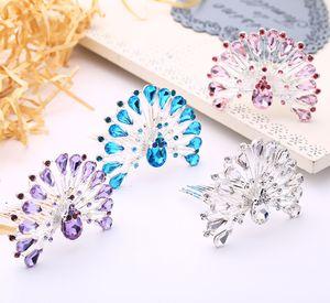 El nuevo inserto de cristal plato de peine del pelo pelo peacock rendimiento peines niños corona fabricante al por mayor