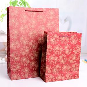 Bolsa de regalo de papel artesanal bolsas de papel para al por mayor bolso de bolso de boda bolsa de embalaje de caramelo bolsa de protección de la protección del medio ambiente