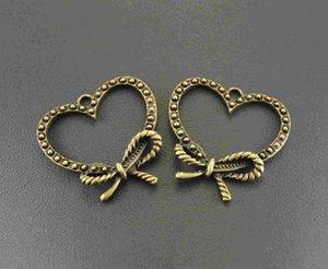 20 unids Vintage bronce corazón arco Charm colgante de metal pulsera collar resultados de la joyería A507