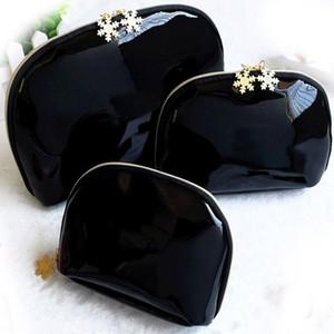 3 unids / set cremallera de los copos de nieve bolsa de maquillaje titular de cosméticos de moda brillante bolsa de embrague del lápiz labial de cuero de Japón bolsos de almacenamiento de tocador de viaje