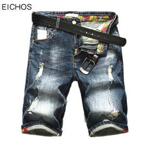 Al por mayor pantalones forman bigote efecto a corto varones sueltos pantalones cortos de mezclilla de los hombres 2017 nueva Europa recta de diseño jeans para hombres