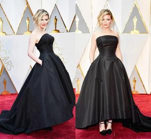 Vestidos de noche de la celebridad Kirsten Dunst 89o Oscar 2014 Vestidos de fiesta negro Vestido de baile sin tirantes sin tirantes Hi-Lo con volantes
