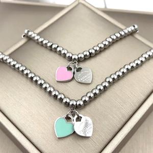 Mode für immer Liebe Doppel Pfirsich Gum Pulver blau Perlen Armband Fashionista Ball Kleber Hand auf Herz