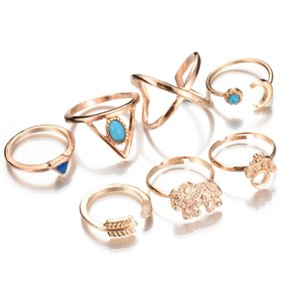 Cluster Rings Bohemian Style 7pcs / lot Vintage Anti Gold Silver Anillos Geometric Blue Stone Elephant Moon Arrow Lucky Rings Set para Mujeres
