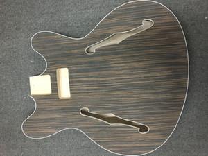 Cuerpo de guitarra eléctrica con chapa de palisandro.