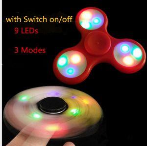 EDC Rainbow Fidget Spinner LED Fidget Tri Spinners Juguetes 3 modos Luminoso Spinner de mano de luz con interruptor ENCENDIDO por DHL