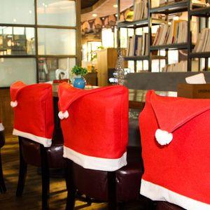 4pcs / set Sombrero Red Chair Nueva fundas para sillas de Santa Decoraciones de Navidad Cena de Navidad Cap Respaldo Deco revestimiento decoración del hogar