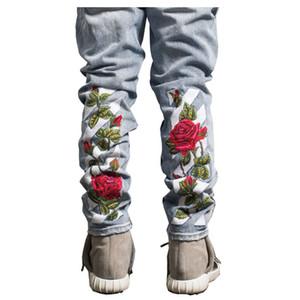 Großhandels- 2017 kühle Rose Blumenstickerei zerrissen Denim Jeans neue Männer 2017 Hallo-Ende Mode Boot Cut Männer männlich Jeans blau schwarz
