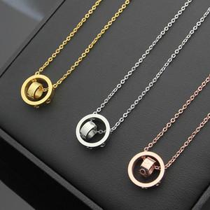 titanio de acero al por mayor tamaño doble del tamaño del anillo collar de pareja en el collar de doble anillo rosa colgante al por mayor collar de oro