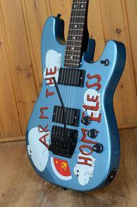 Guitare électrique bleu métallique sans fil de bras de Tom Morello fait sur commande de bras, pont noir de Tremolo de Floyd Rose, incrustation de touche de point blanc de MOP