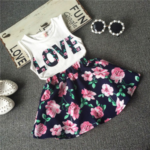 2017 crianças meninas casual shirt camisola de alças de amor + saia de flor roupas set verão moda conjunto de roupas impresso roupa do bebê terno