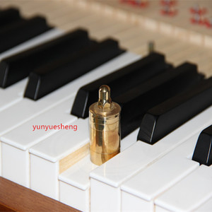 White piano keys measuring heavy weights (copper   70 g) jack