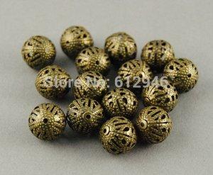¡Envío gratis! 100 unids Antique Bronze Filigree Beads Spacer Hollow Beads 12mm Metal pulsera collar de la joyería resultados