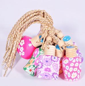 MINI Ambientador de coche aceites esenciales botella de perfume del coche colgante redondo accesorios del coche auto porcelana perfumes de cerámica