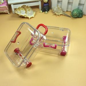 Diseño de equipaje de viaje transparente Caja de dulces de plástico Caja mini maleta Boda Baby Shower Cajas de chocolate Regalos de Navidad 9 Color WX9-945