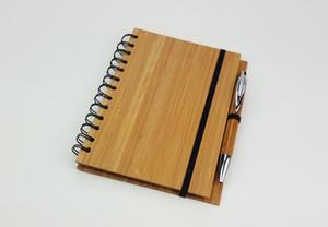 펜 70 장을 가진 목제 대나무 덮개 노트북 메모장은 일렬로 세워진 종이를 재생했습니다