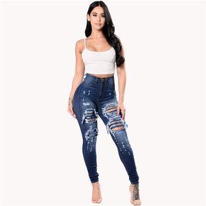 Agujeros de Europa US mujeres hueco de la manera ocasional de los pantalones vaqueros de alta calidad de algodón azul denim suavizante botones de cintura ajustada Zipper pantalones delgados