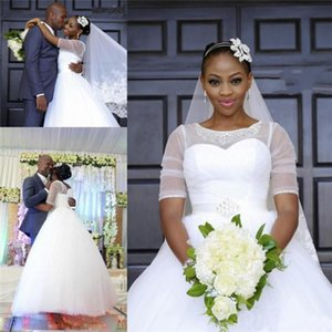 African Plus Size Wedding Dress With Sash Sheer Neck Lace Appliques Beaded White Half Sleeves Dubai Bridal Gowns