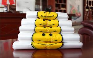 Vente chaude Transparent Visage Souriant Portable Sacs En Plastique Sur Mesure Produit Frais Étanche Multi-fonction Gilet Shopping Sacs 100 pièces