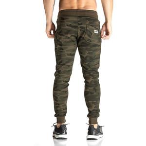 Hombres bordados Pantalones de ropa deportiva completa Algodón elástico casual Pantalones de entrenamiento de fitness para hombre Pantalones de chándal pitillo Pantalones de chándal