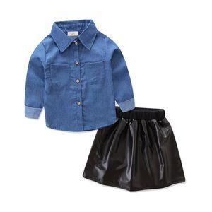 Großhandelskinder Designerkleidung Mädchen Mode INS Anzug Langarm-Jeanshemd + Leder Rock 2 Stück gesetzten Klage-Baby-Designer-Kleidung