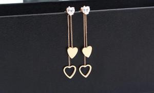 Pendientes largos con flecos de diamantes de doble corazón con flecos europeos y americanos, versátiles pendientes de oro rosa chapados en acero de titanio